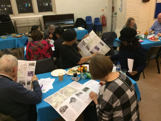 Quiz time:  looking for quiz answers on the printed map! |  Photo courtesy of Newham New Deal Partnership
